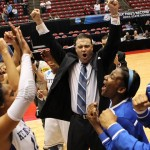 Kentucky coach Matthew Mitchell and players celebrate. Photo: Britney McIntosh, UK Athletics