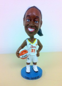 Tina Charles bobblehead handed out at the game.